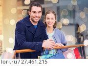 Купить «happy young couple with shopping bags in mall», фото № 27461215, снято 10 ноября 2014 г. (c) Syda Productions / Фотобанк Лори
