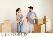 Купить «couple with boxes and lamp moving to new home», фото № 27461351, снято 4 июня 2017 г. (c) Syda Productions / Фотобанк Лори