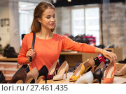 Купить «happy young woman choosing shoes at store», фото № 27461435, снято 22 сентября 2017 г. (c) Syda Productions / Фотобанк Лори