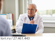 Купить «senior doctor talking to male patient at hospital», фото № 27461443, снято 6 октября 2017 г. (c) Syda Productions / Фотобанк Лори