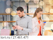 Купить «couple with smartphones and shopping bags in mall», фото № 27461471, снято 10 ноября 2014 г. (c) Syda Productions / Фотобанк Лори