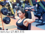 Купить «young woman flexing muscles with dumbbell in gym», фото № 27461515, снято 12 декабря 2015 г. (c) Syda Productions / Фотобанк Лори