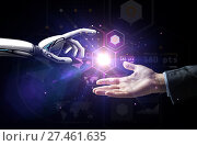 robot and human hand over virtual projection. Стоковое фото, фотограф Syda Productions / Фотобанк Лори