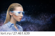 woman in virtual reality glasses over space. Стоковое фото, фотограф Syda Productions / Фотобанк Лори