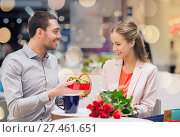 Купить «happy couple with present and flowers in mall», фото № 27461651, снято 10 ноября 2014 г. (c) Syda Productions / Фотобанк Лори