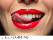 Купить «close up of woman with red lipstick licking lips», фото № 27461743, снято 5 января 2018 г. (c) Syda Productions / Фотобанк Лори