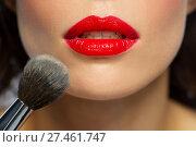 Купить «face of woman with red lipstick applying powder», фото № 27461747, снято 5 января 2018 г. (c) Syda Productions / Фотобанк Лори
