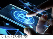 close up of hands with smartphone and bitcoin. Стоковое фото, фотограф Syda Productions / Фотобанк Лори