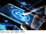 Купить «close up of hands with smartphone and bitcoin», фото № 27461751, снято 6 сентября 2016 г. (c) Syda Productions / Фотобанк Лори