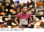 Купить «male musician with cymbals at music store», фото № 27461779, снято 11 декабря 2014 г. (c) Syda Productions / Фотобанк Лори