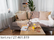 Купить «sofa with cushions at cozy home living room», фото № 27461819, снято 15 ноября 2017 г. (c) Syda Productions / Фотобанк Лори