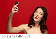 Купить «beautiful woman taking selfie with smartphone», фото № 27461859, снято 5 января 2018 г. (c) Syda Productions / Фотобанк Лори