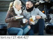 Купить «couple posing near motor bike with sandwitches and coffee», фото № 27464427, снято 22 октября 2018 г. (c) Яков Филимонов / Фотобанк Лори