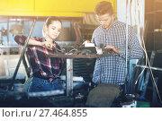 Купить «Two young professional masters working in workshop», фото № 27464855, снято 10 октября 2017 г. (c) Яков Филимонов / Фотобанк Лори