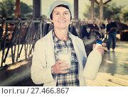 Купить «mature woman is standing at the cow farm», фото № 27466867, снято 24 октября 2017 г. (c) Яков Филимонов / Фотобанк Лори