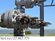 Купить «Equipment of an oil well», фото № 27467771, снято 19 июля 2015 г. (c) Леонид Еремейчук / Фотобанк Лори
