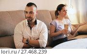 Купить «Husband is upset because his wife is watching football at home.», видеоролик № 27468239, снято 27 ноября 2017 г. (c) Яков Филимонов / Фотобанк Лори