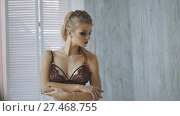 Купить «Blonde young woman model in underwear in studio», фото № 27468755, снято 18 марта 2018 г. (c) Константин Шишкин / Фотобанк Лори