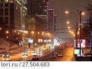Купить «Москва, автомобили на Новом Арбате едущие в центр», эксклюзивное фото № 27504683, снято 3 января 2017 г. (c) Дмитрий Неумоин / Фотобанк Лори
