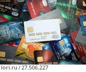 Купить «White blank credit cards mockup onthe background of colorful credit cards of the different banks.», фото № 27506227, снято 19 августа 2018 г. (c) Maksym Yemelyanov / Фотобанк Лори