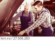 Купить «Two car mechanics at workshop», фото № 27506283, снято 16 октября 2018 г. (c) Яков Филимонов / Фотобанк Лори