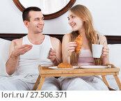 Купить «Happy smiling man and beautiful girlfriend with tasty breakfast», фото № 27506371, снято 16 июня 2019 г. (c) Яков Филимонов / Фотобанк Лори