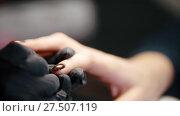 Купить «Manicure in beauty salon - cosmetic master in medical mask deals polish on the nails», видеоролик № 27507119, снято 16 августа 2018 г. (c) Константин Шишкин / Фотобанк Лори