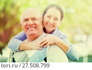 Купить «Senior man and mature woman against blured trees», фото № 27508799, снято 27 мая 2020 г. (c) Яков Филимонов / Фотобанк Лори