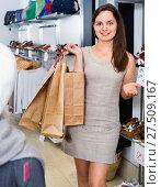 Купить «Happy brunette posing with bags in footwear shop», фото № 27509167, снято 26 сентября 2016 г. (c) Яков Филимонов / Фотобанк Лори