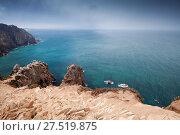 Купить «Coastal rocks of Cabo da Roca under stormy sky», фото № 27519875, снято 14 августа 2017 г. (c) EugeneSergeev / Фотобанк Лори
