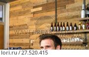 Купить «Waiter talking on mobile phone at counter 4k», видеоролик № 27520415, снято 10 декабря 2018 г. (c) Wavebreak Media / Фотобанк Лори