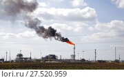 Купить «The smoking gas torch. Environmental pollution. Torch system on an oil field», видеоролик № 27520959, снято 23 января 2018 г. (c) Леонид Еремейчук / Фотобанк Лори