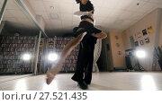 Купить «Young man and woman dancing and practicing Latin American dance in costumes in the Studio, slow motion, in action», видеоролик № 27521435, снято 23 июля 2019 г. (c) Константин Шишкин / Фотобанк Лори