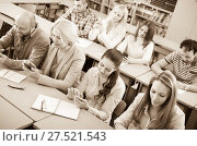 Купить «Adult students in classroom», фото № 27521543, снято 17 декабря 2018 г. (c) Яков Филимонов / Фотобанк Лори