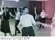 Купить «People practicing passionate samba in dance class», фото № 27521679, снято 24 мая 2017 г. (c) Яков Филимонов / Фотобанк Лори