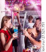 Купить «Female and male clubbing with cocktail in the club on party», фото № 27521751, снято 28 августа 2017 г. (c) Яков Филимонов / Фотобанк Лори