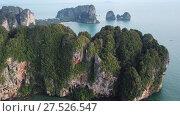 Купить «Aerial view of tropical lagoon beach between rocks», видеоролик № 27526547, снято 21 января 2018 г. (c) Михаил Коханчиков / Фотобанк Лори