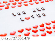 Купить «Valentines day background. Red hearts and inscription You are loved on the white wooden background. St Valentines day festive still life», фото № 27530479, снято 21 января 2018 г. (c) Зезелина Марина / Фотобанк Лори