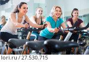 Купить «Females cycling in sport club», фото № 27530715, снято 20 июля 2018 г. (c) Яков Филимонов / Фотобанк Лори