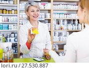 Купить «Seller helping customer to choose care products», фото № 27530887, снято 15 марта 2017 г. (c) Яков Филимонов / Фотобанк Лори
