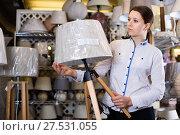 Купить «Woman is choosing new lamp for her home in the store.», фото № 27531055, снято 20 декабря 2017 г. (c) Яков Филимонов / Фотобанк Лори