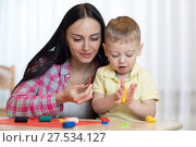 Купить «Woman teaches child handcraft», фото № 27534127, снято 26 марта 2019 г. (c) Оксана Кузьмина / Фотобанк Лори