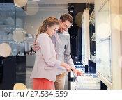 Купить «happy couple choosing engagement ring in mall», фото № 27534559, снято 10 ноября 2014 г. (c) Syda Productions / Фотобанк Лори