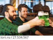 Купить «male friends drinking green beer at bar or pub», фото № 27534567, снято 22 апреля 2015 г. (c) Syda Productions / Фотобанк Лори