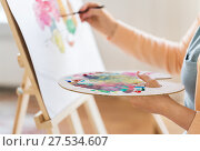 Купить «artist with palette and brush painting at studio», фото № 27534607, снято 1 июня 2017 г. (c) Syda Productions / Фотобанк Лори