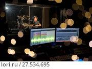 Купить «man playing drum kit at sound recording studio», фото № 27534695, снято 18 августа 2016 г. (c) Syda Productions / Фотобанк Лори