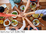 Купить «people holding hands together over table with food», фото № 27534743, снято 5 октября 2017 г. (c) Syda Productions / Фотобанк Лори