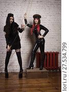 Купить «Two fetish models in military uniform», фото № 27534799, снято 20 ноября 2017 г. (c) Дмитрий Черевко / Фотобанк Лори