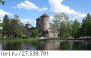 Купить «Летний пейзаж со старинной крепостью. Савонлинна, Финляндия», видеоролик № 27538791, снято 17 июня 2017 г. (c) Виктор Карасев / Фотобанк Лори