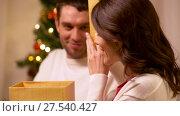 Купить «happy couple with christmas gift at home», видеоролик № 27540427, снято 17 января 2018 г. (c) Syda Productions / Фотобанк Лори